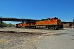 BNSF 4688 leads a Empty grain train Nb under the Up bridge,